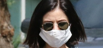Lucy Hale wore a mask to take her maltipoo Elvis for a walk in LA