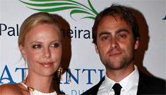 Charlize Theron spanks stranger, Stuart Townsend gets pissed