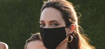 Angelina Jolie stepped out for a super-obvious pap stroll which was beneath her
