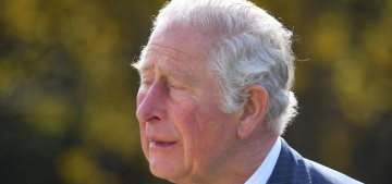 Prince Charles looked emotional as he visited the makeshift memorial to his late father