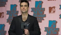 Robbie Williams conned out of $400,000 by friends