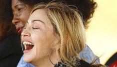 Madonna, clad in stilettos, plants a tree in Malawi