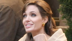 Can Angelina Jolie still heal with her touch while wearing gloves?