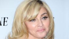 Madonna gives her new boy-toy Adam Senn a public lap dance