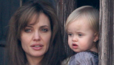Angelina Jolie & Grandma Pitt bring the twins out to the balcony