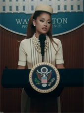 Still of Ariana Grande as President in the video for Positions
