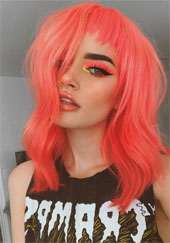Woman with coral colored hair