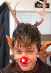 Pete Davidson dressed as a reindeer