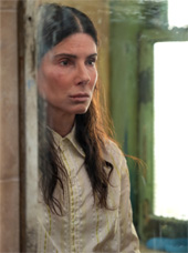 Still of Sandra Bullock in The Unforgivable looking into a dirty mirror. Credit: Netflix Press