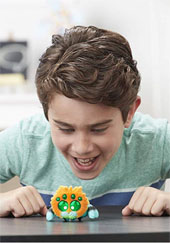 Picture of boy yelling at plush spider